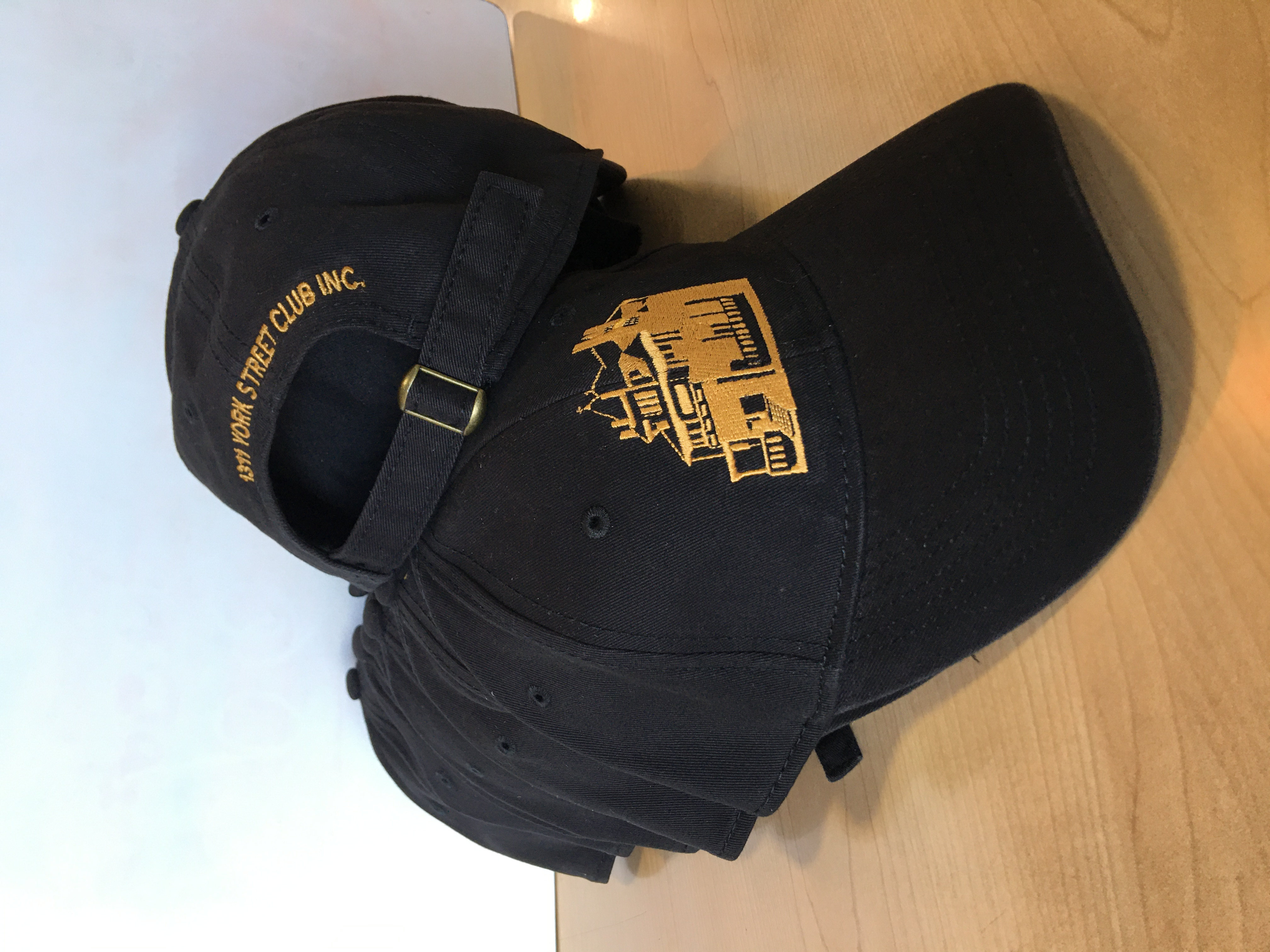 Black and Gold Embroidered Hat in two locations