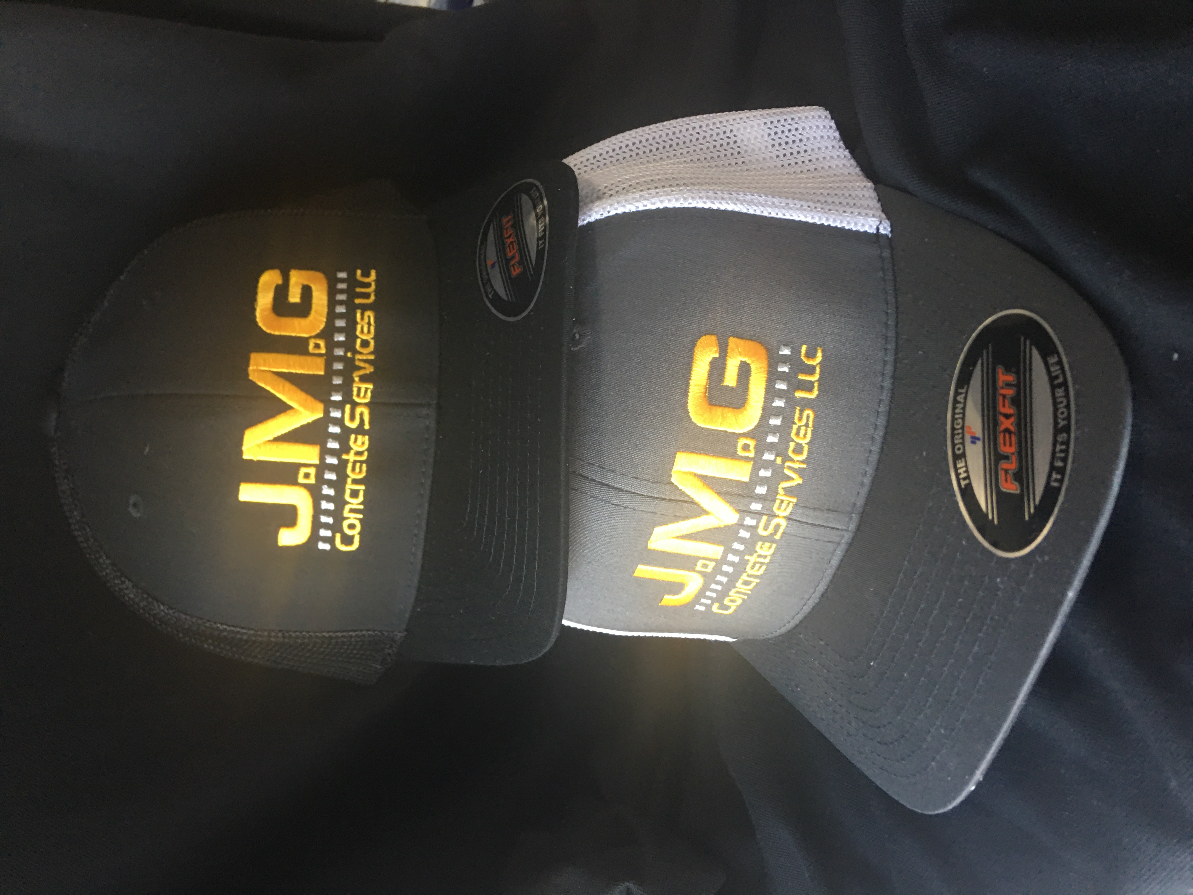 Embroidered logo on two different hats